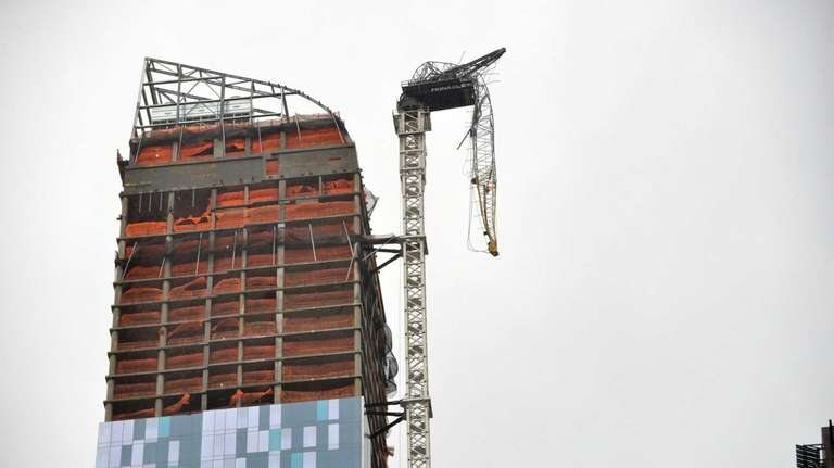 The top section of a construction crane dangles