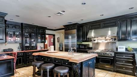 """The kitchen has beautiful European custom cabinets and"