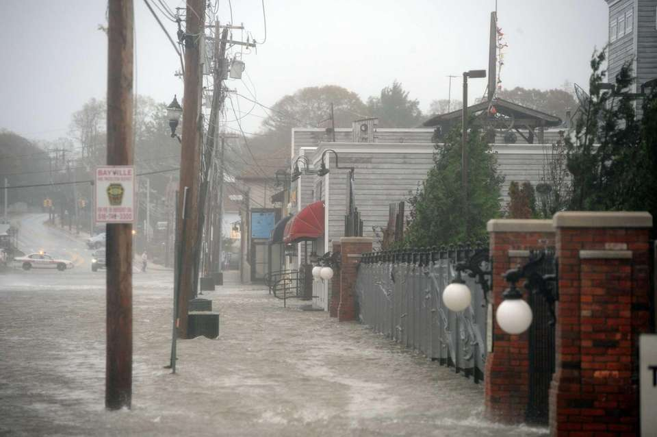Water floods Bayville Avenue in Bayville, up to