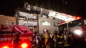 FDNY firefighters respond to the collapsed facade of