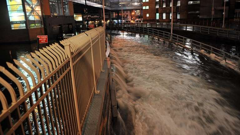 Water floods down the Brooklyn Battery Tunnel in