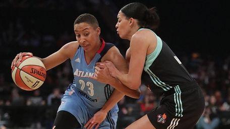 Atlanta Dream guard Layshia Clarendon (23) drives against