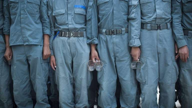 Afghan National Police officers line up at the