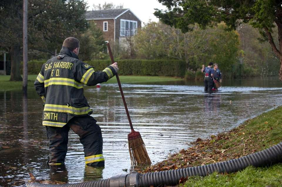 Sag Harbor Fire Department members pump flood waters