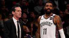 Nets head coach Kenny Atkinson and guard Kyrie