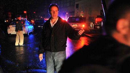 Gov. Andrew Cuomo walks through lower Manhattan early