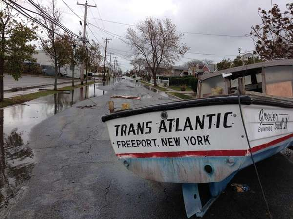 A boat is beached on South Ocean Avenue
