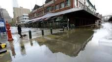 Flooding, like here at the South Street Seaport,