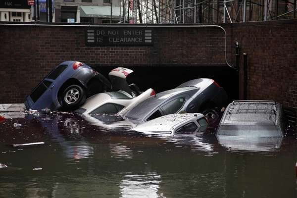 Cars are submerged at the entrance to a