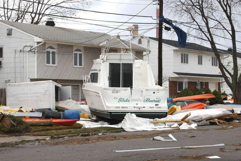 A boat rests in front of a house