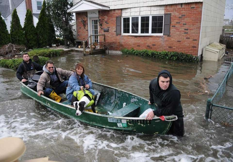 A family evacuates Surf Street in Lindenhurst a