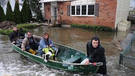 A family evacuates Surf Street in Lindenhurst a