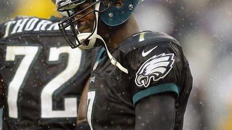 Eagles quarterback Michael Vick looks dejected as he