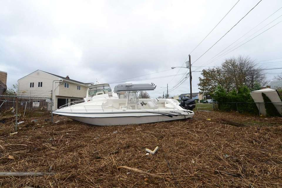 A boat lies on debris in Long Beach
