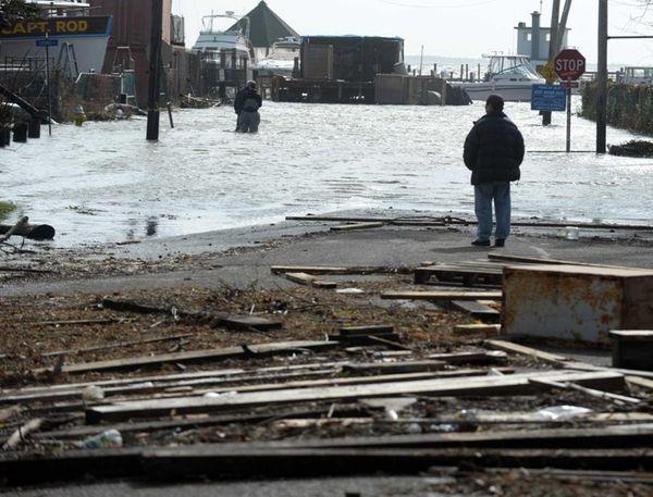Debris is strewn across West Avenue in Sayville