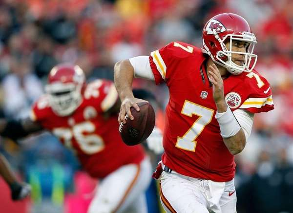Chiefs quarterback Matt Cassel scrambles during a game