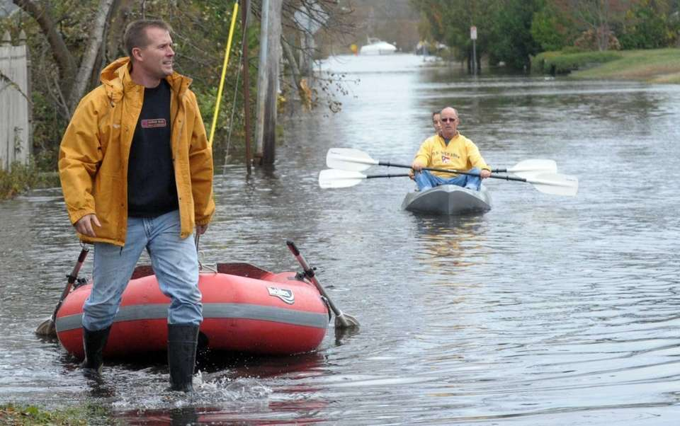 Dave Loudon, left, of Sayville makes his way