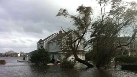 A flooded house a few hundred yards from