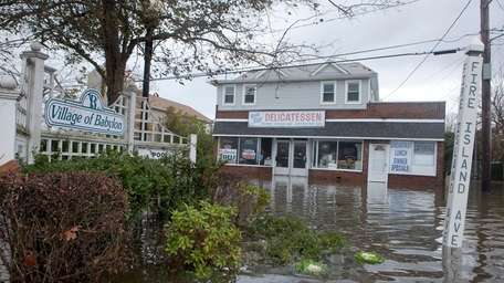Floodwaters swamp houses and businesses along Fire Island