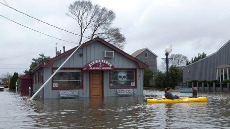 A kayaker paddles near Seabreeze Cafe in Babylon