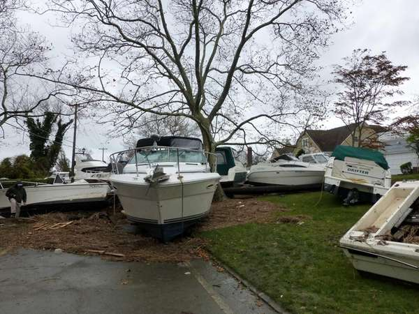 Superstorm Sandy has left boats strewn along front