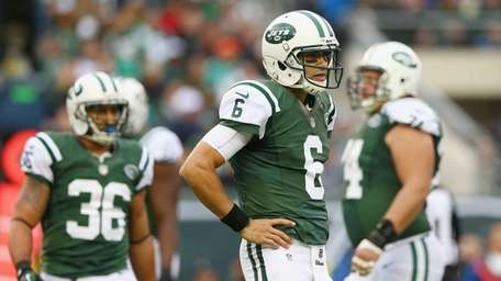Mark Sanchez looks to the bench for the