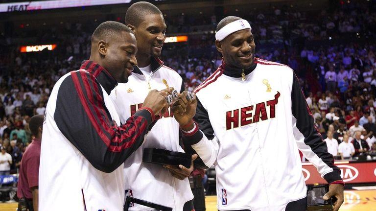 From left, Miami Heat guard Dwyane Wade, forward