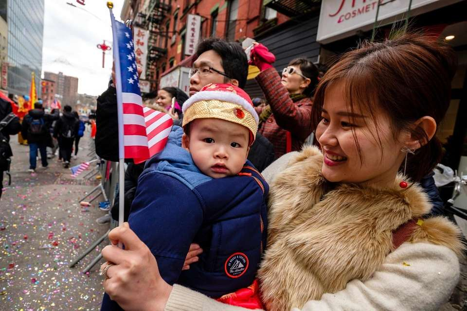Spectators watch the Lunar New Year parade on