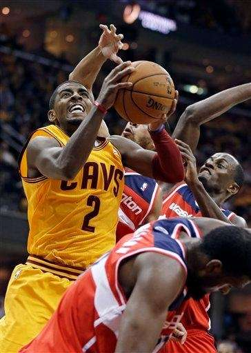 Cleveland Cavaliers guard Kyrie Irving drives through a