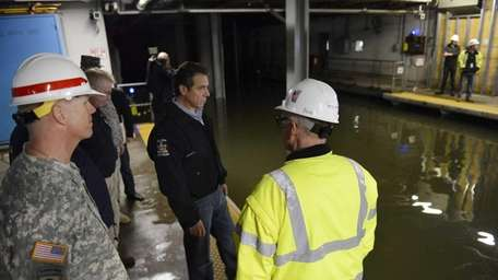 Gov. Andrew M. Cuomo assesses water levels in