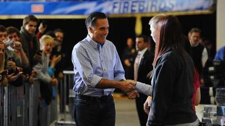 Republican Presidential candidate Mitt Romney greets supporters during