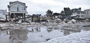 A beachfront house is damaged in the aftermath