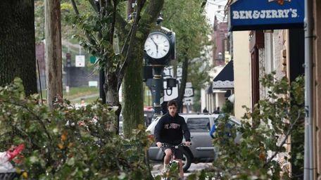 A bicyclist makes his way Monday along Main