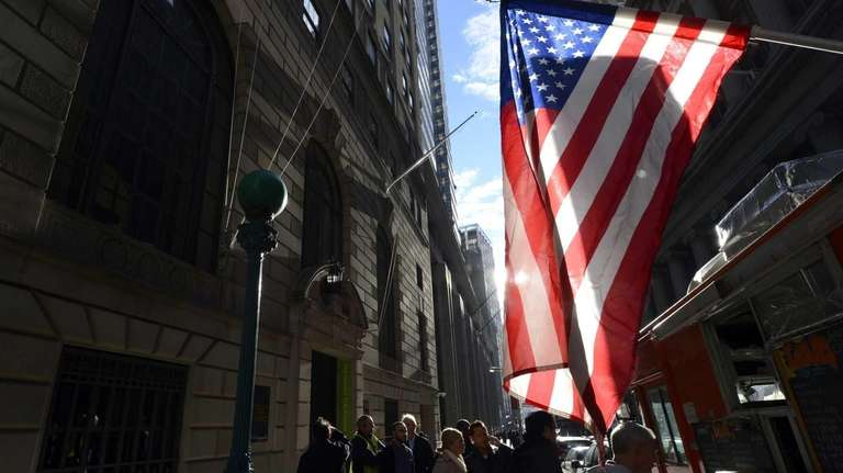People go back to work on Wall Street