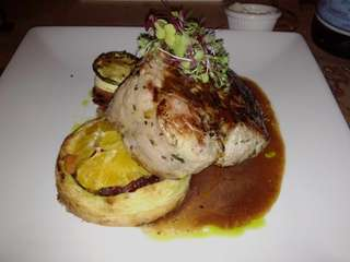 Wood-fired double-cut pork chop at Thyme in Roslyn.