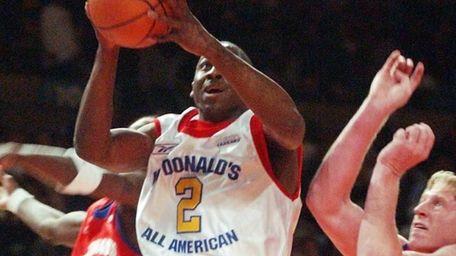 East's Raymond Felton shoots a layup past West's