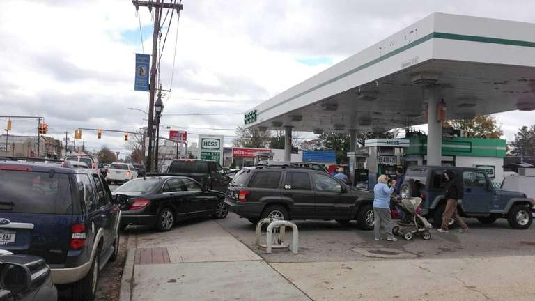 Cars wait on line to buy gas at