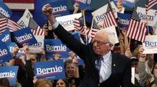 Bernie Sanders speaks to supporters Tuesday night in
