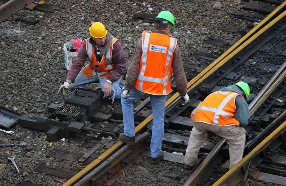 Metro-North Railroad crews work on the tracks and