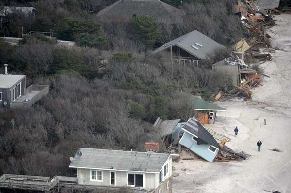 Damaged and collapsed oceanfront homes are seen from