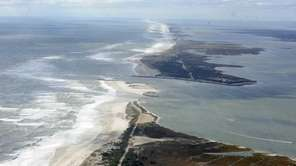 This aerial photograph of Morcihes Inlet, looking west,