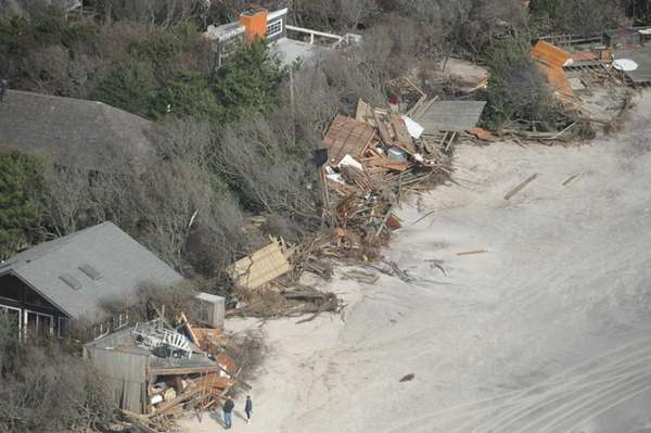 People inspect the oceanfront homes at Davis Park,