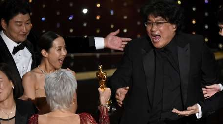 Bong Joon Ho, right, reacts as he is