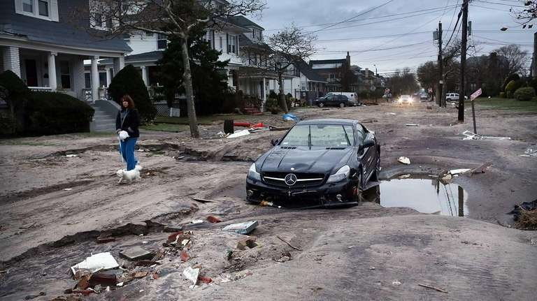 Damage is viewed in the Rockaway neighborhood where