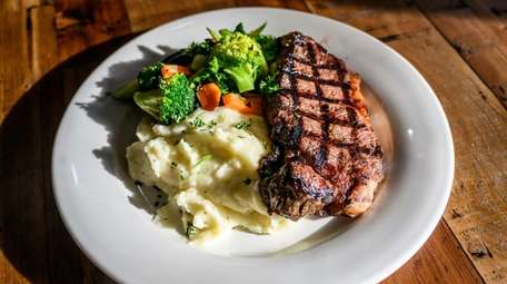 The grilled shell steak is served with mashed