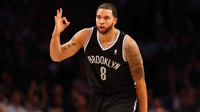 Deron Williams celebrates after hitting a 3-pointer in