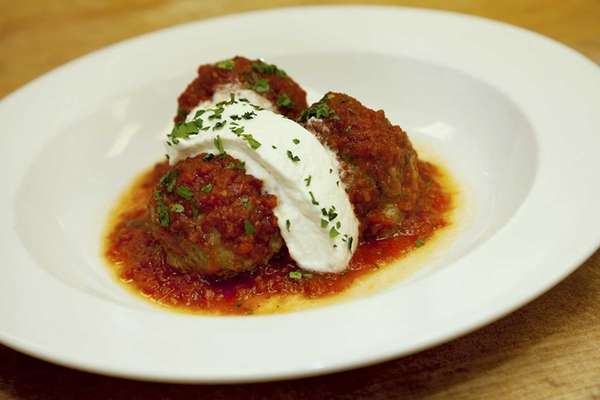 The veal, pork and beef meatballs, dolloped with