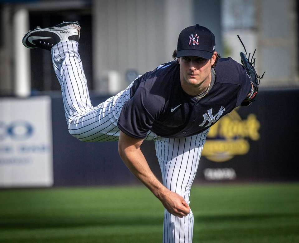 Yankees pitcher Gerrit Cole warms up his arm