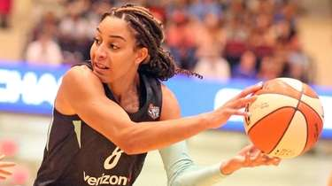 The Liberty's Bria Hartley passes against the Chicago