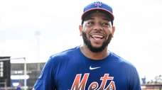 Mets first baseman Dominic Smith smiles during a